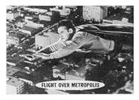 Superman trading cards. Superman flying over Metropolis.